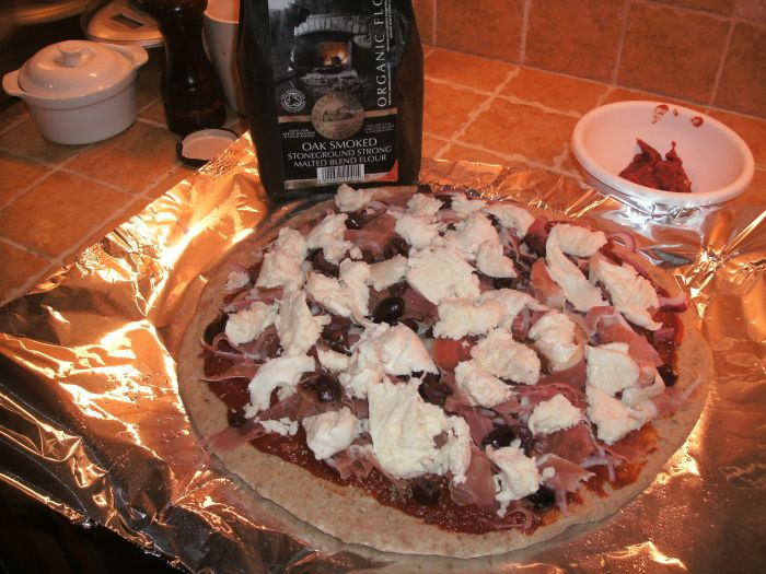 Oak smoked pizza before bake