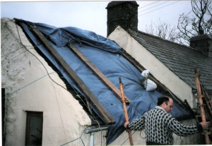 Roof covered with tarpaulin