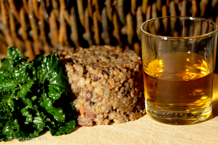 Vegetarian haggis, with flower sprouts and whiskey